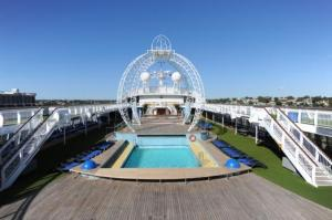 An amazing high-wire circus and trapeze arena on the top deck Pacific Jewel